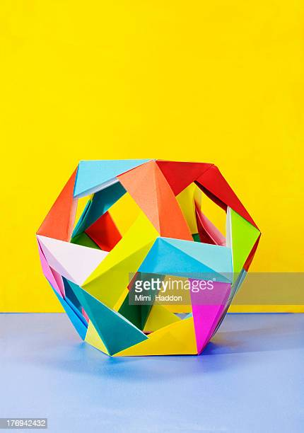 modular origami sculpture on colorful background - sculptuur stockfoto's en -beelden
