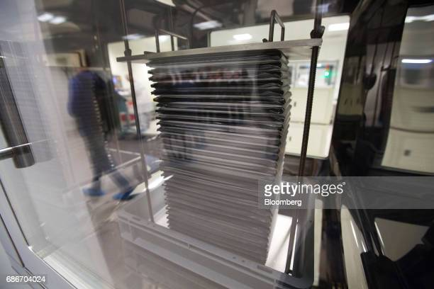 A module containing supercapacitor base cells sit in a controlled environment booth in the research and development laboratory at Renova Group's...