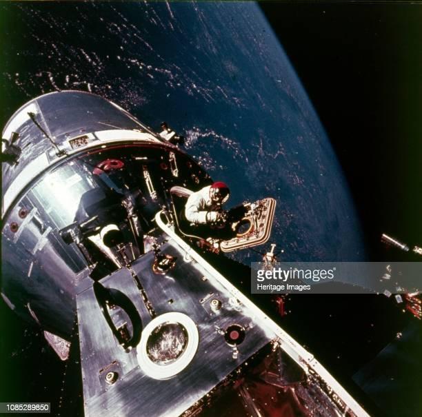 Module pilot David Scott emerging from Apollo 9 spacecraft 6 March 1969 Apollo 9 Command/Service Modules nicknamed 'Gumdrop' and Lunar Module...