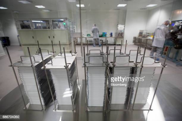 Modules containing supercapacitor base cells sit before unit assembly in the research and development laboratory at Renova Group's TEEMP production...