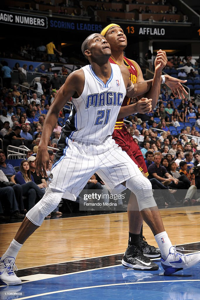 Moe Harkless #21 of the Orlando Magic fights for position against Kevin Jones #5 of the Cleveland Cavaliers on February 23, 2013 at Amway Center in Orlando, Florida.