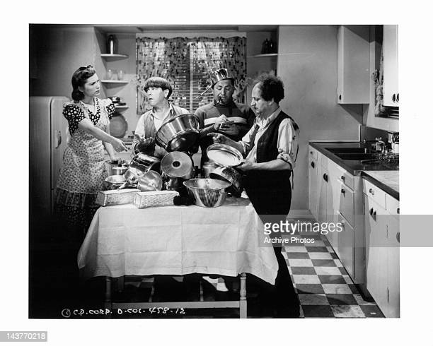 Moe Howard Curly Howard Larry Fine as the Three Stooges in a scene from uknown film Circa 1940