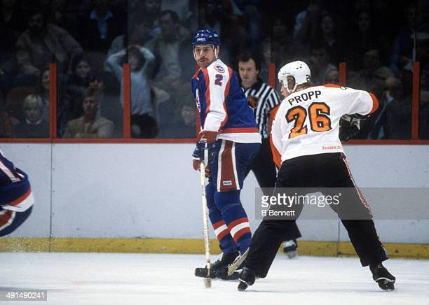 Moe Mantha of the Winnipeg Jets skates on the ice as he is defended by Brian Propp of the Philadelphia Flyers on December 1 1981 at the Spectrum in...