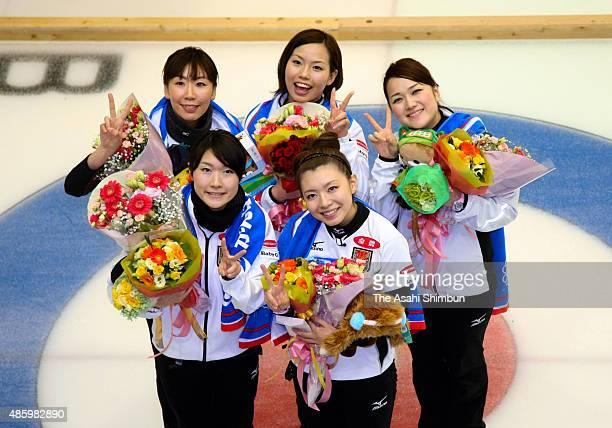 Moe Meguro and Mari Motohashi Kotomi Ishizaki Anna Ohmiya and Mayo Yamaura of Team Aomori celebrate winning the Curling Vancouver Olympic Japan team...