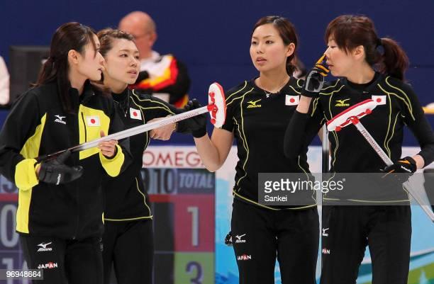Moe Meguro, Mari Motohashi, Anna Ohmiya and Kotomi Ishizaki of Japan look on during the women's curling round robin game between Japan and Germany on...