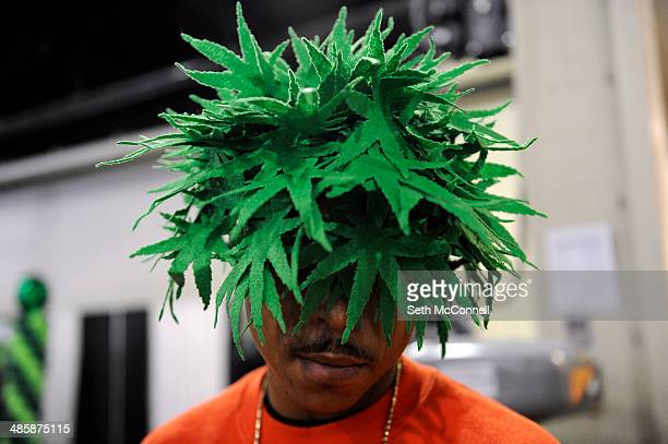 Moe Money of Chicago Illinois displays his marijuana leaf hat during the High Times Cannabis Cup at Denver Mart in Denver Colorado on April 20 2014...