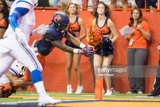 Moe Neal of the Syracuse Orange carries the ball during a touchdown pass reception that made the score 310 over Central Connecticut State Blue Devils...