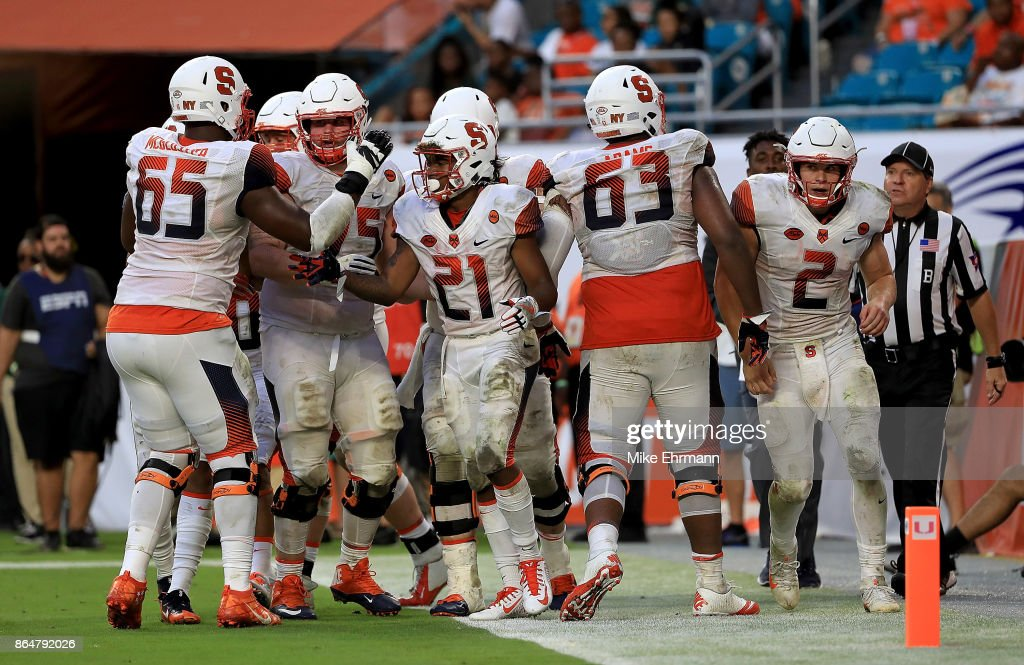 Moe Neal #21 of the Syracuse Orange celebrates a touchdown during a game against the Miami Hurricanes at Sun Life Stadium on October 21, 2017 in Miami Gardens, Florida.