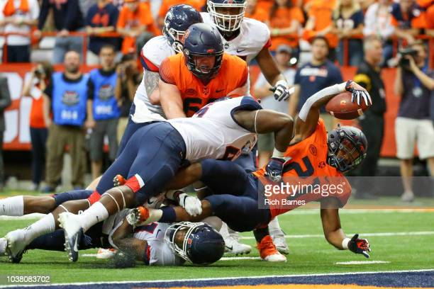 Moe Neal of the Syracuse Orange reaches for the end zone on a run but would fall short against the Connecticut Huskies during the third quarter at...