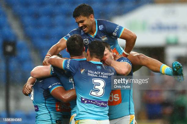 Moeaki Fotuaika of the Titans celebrates a try during the round 25 NRL match between the Gold Coast Titans and the New Zealand Warriors at Cbus Super...