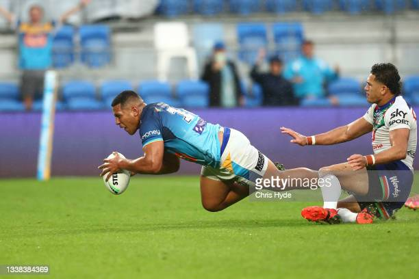 Moeaki Fotuaika of the Titans scores a try during the round 25 NRL match between the Gold Coast Titans and the New Zealand Warriors at Cbus Super...