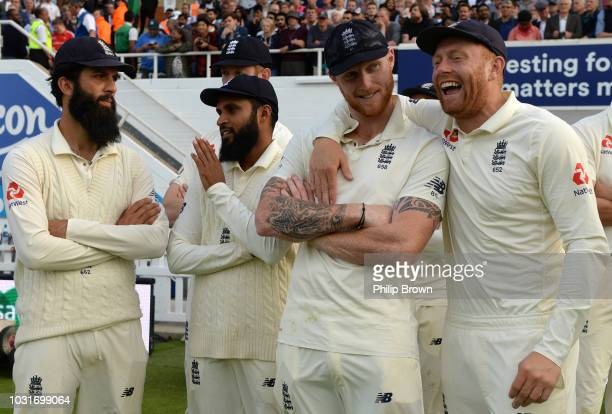 Moeen Ali Adil Rashid Ben Stokes and Jonny Bairstow wait for the presentations after England won the fifth Specsavers Test Match between England and...