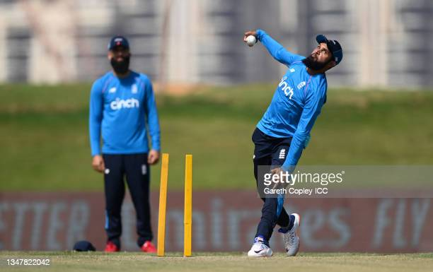 Moeen Ali and Adil Rashid of England warm up ahead of the England and New Zealand warm Up Match prior to the ICC Men's T20 World Cup at on October...