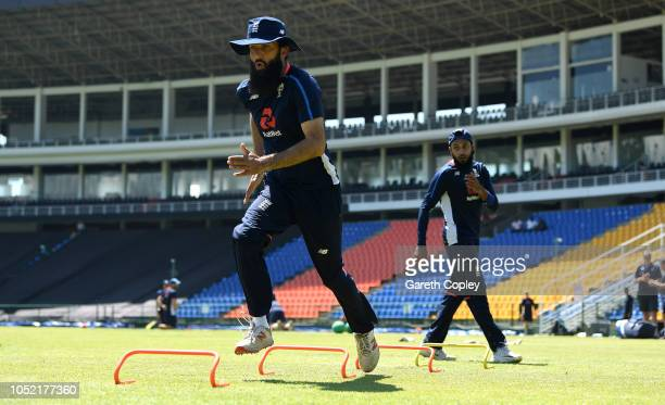 Moeen Ali and Adil Rashid of England warm up during a nets session at Pallekele International Cricket Stadium on October 15 2018 in Kandy