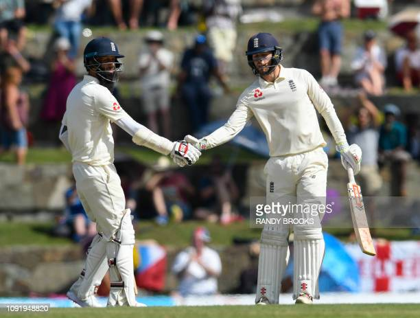 Moeen Ali and Ben Foakes of England 50 runs partnership during day 1 of the 2nd Test between West Indies and England at Vivian Richards Cricket...
