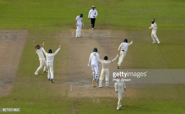 Moeen Ali and Ben Stokes of England celebrates after the dismissal of Duanne Olivier of South Africa as England won the 4th Investec Test match...