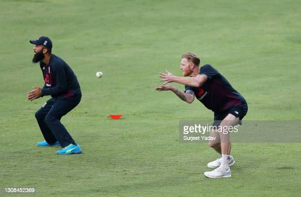 Moeen Ali and Ben Stokes of England practice in the slips during a England Net Session at Maharashtra Cricket Association Stadium on March 22, 2021...