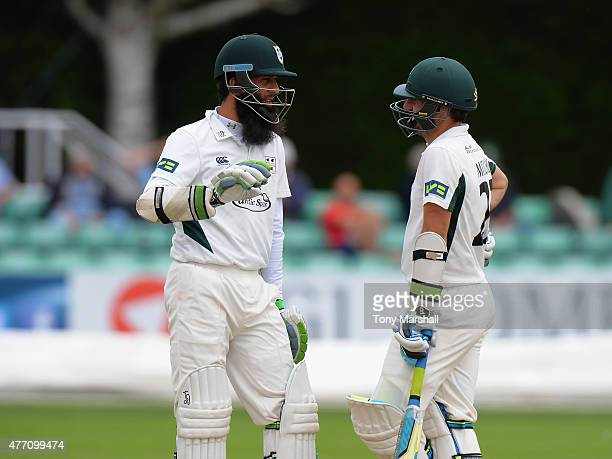 Moeen Ali and Daryl Mitchell of Worcestershire talk inbetween overs during the LV County Championship match between Worcestershire and Warwickshire...