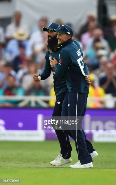 Moeen Ali is hugged by Joe Root of England after he catches D'Arcy Short during the 3rd Royal London ODI match between England and Australia at Trent...