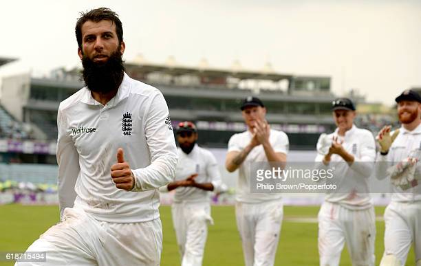 Moeen Ali leaves the field after taking five wickets during the second test match between Bangladesh and England at Shere Bangla National Stadium on...