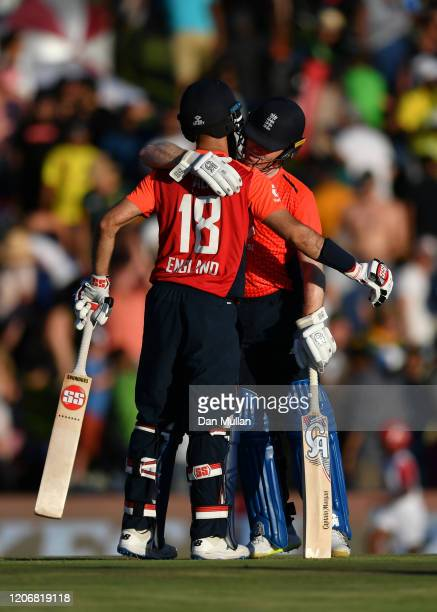 Moeen Ali of England and Eoin Morgan of England embrace after securing victory during the Third T20 International match between South Africa and...