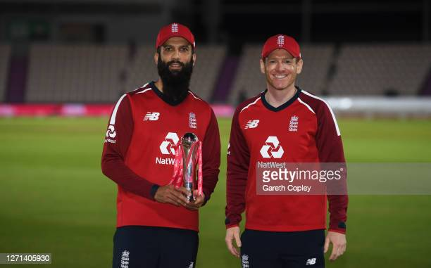 Moeen Ali of England and Eoin Morgan of England pose with the trophy after winning the series 2-1 during the 3rd Vitality International Twenty20...