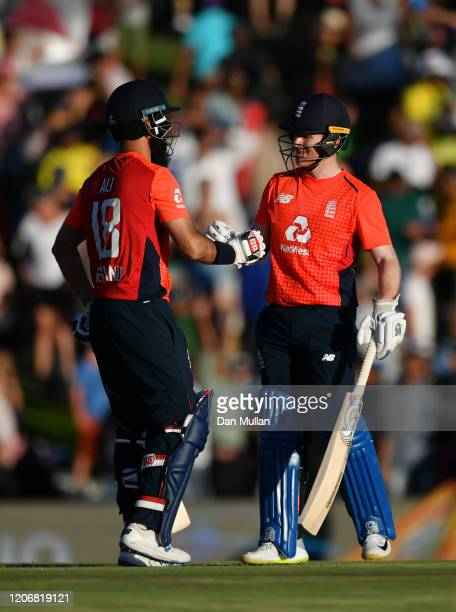 Moeen Ali of England and Eoin Morgan of England shake hands after securing victory during the Third T20 International match between South Africa and...