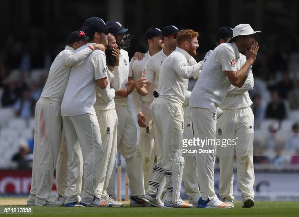 Moeen Ali of England and teammates wait for the referee's decision for the wicket of Morne Morkel of South Africa for his hattrick during day five of...