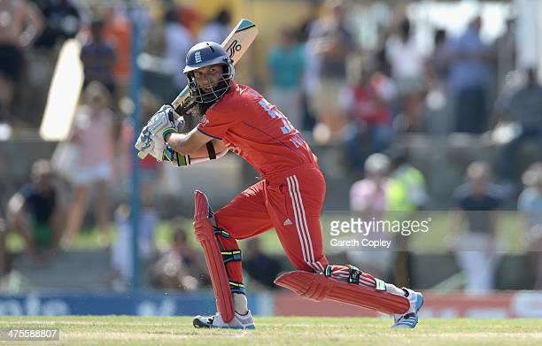 Moeen Ali of England bats during the 1st One Day International between West Indies and England at Sir Viv Richards Cricket Ground on February 28 2014...