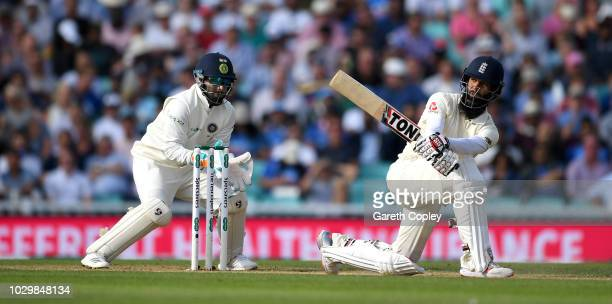 Moeen Ali of England bats watched by India wicketkeeper Rishabh Pant during day three of the Specsavers 5th Test match between England and India at...