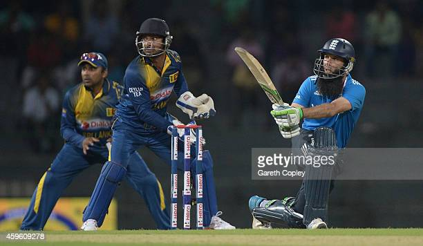 Moeen Ali of England bats watched by Kumar Sangakkara and Mahela Jayawardena of Sri Lanka during the 1st One Day International between Sri Lanka and...