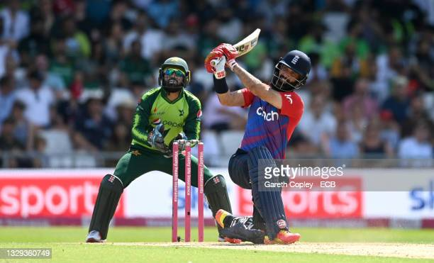 Moeen Ali of England bats watched by Pakistan wicketkeeper Mohammad Rizwan during the Second Vitality International T20 match between England and...