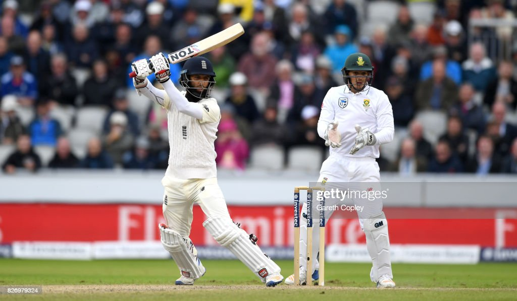 Moeen Ali of England bats watched by South Africa wicketkeeper Quinton de Kock during day three of the 4th Investec Test match between England and South Africa at Old Trafford on August 6, 2017 in Manchester, England.