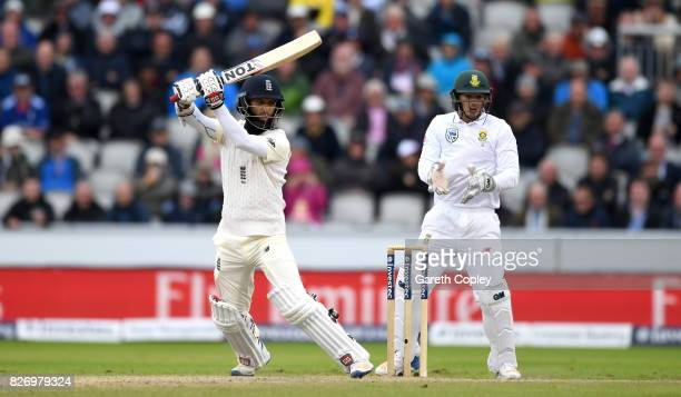 Moeen Ali of England bats watched by South Africa wicketkeeper Quinton de Kock during day three of the 4th Investec Test match between England and...