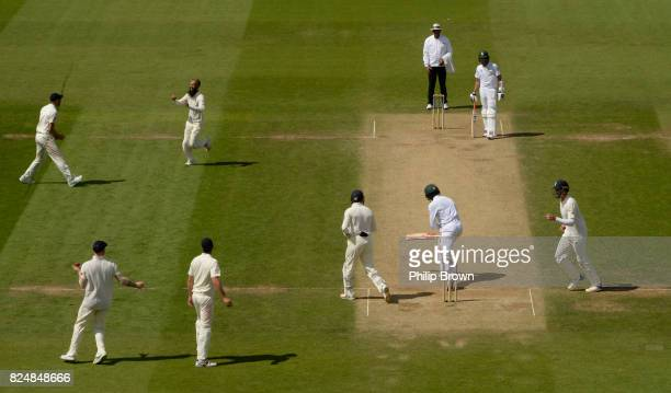 Moeen Ali of England celebrates after dismissing Kagiso Rabad of South Africa during the fifth day of the 3rd Investec Test match between England and...