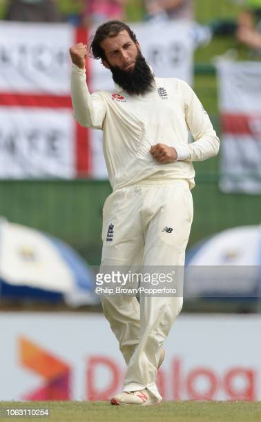 Moeen Ali of England celebrates after the dismissal of Niroshan Dickwella during the 2nd Cricket Test Match between Sri Lanka and England at...