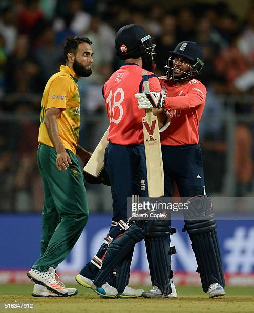 Moeen Ali of England celebrates hitting the winning runs with Adil Rashid to win the ICC World Twenty20 India 2016 Super 10s Group 1 match between...
