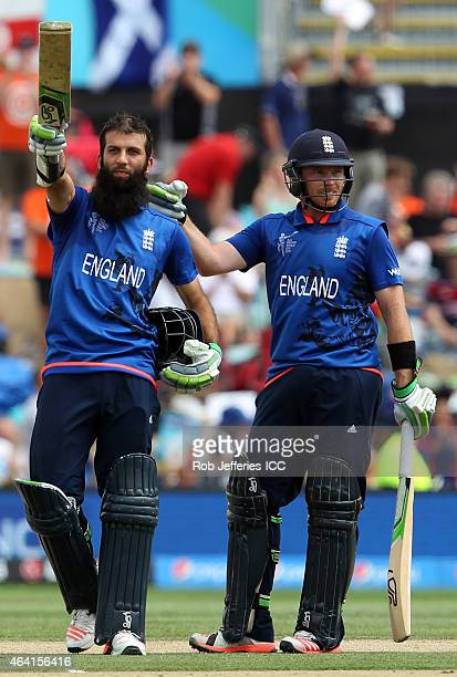 Moeen Ali of England celebrates scoring 100 runs with Ian Bell during the 2015 ICC Cricket World Cup match between England and Scotland at Hagley...