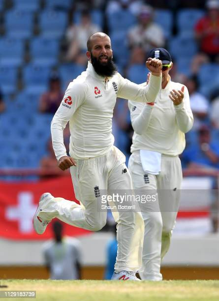 Moeen Ali of England celebrates taking the wicket of Shane Dowrich of the West Indies during Day Four of the Third Test match between the West Indies...