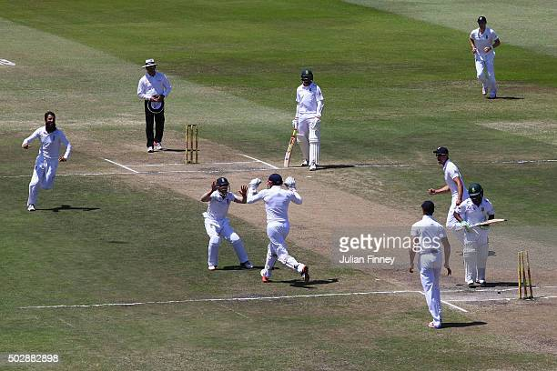 Moeen Ali of England celebrates taking the wicket of Temba Bavuma of South Africa after Jonny Bairstow of England stumped him during day five of the...