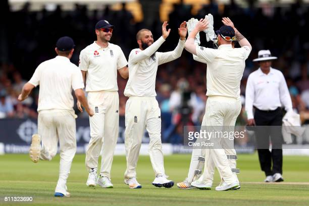 Moeen Ali of England celebrates the wicket of Quinton de Kock of South Africa on day four of the 1st Investec Test match between England and South...