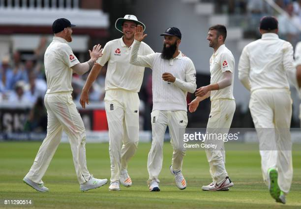 Moeen Ali of England celebrates with Ben Stokes Stuart Broad and Mark Wood after catching out JeanPaul Duminy of South Africa during the 4th day of...