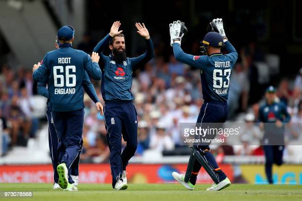 Moeen Ali of England celebrates with his teammates after dismissing Shaun Marsh of Australia during the 1st Royal London ODI match between England...