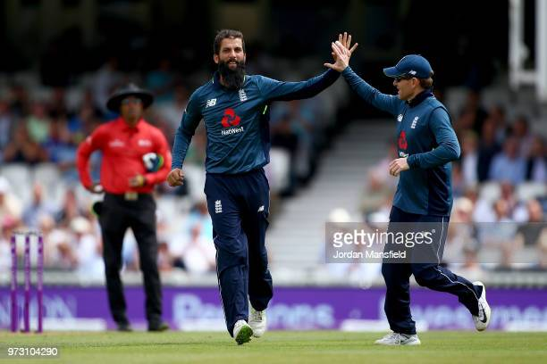 Moeen Ali of England celebrates with his teammates after dismissing Tim Paine of Australia during the 1st Royal London ODI match between England and...