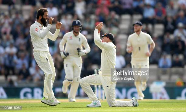 Moeen Ali of England celebrates with Joe Root after dismissing Hardik Pandya of India during day two of the Specsavers 4th Test match between England...