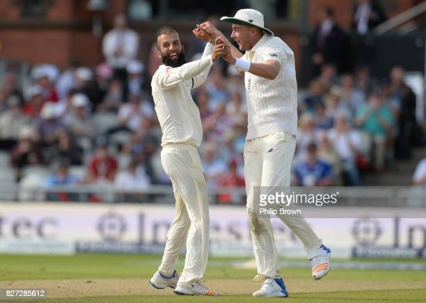 Moeen Ali of England celebrates with Stuart Broad after dismissing Theunis de Bruyn of South Africa during the fourth day of the 4th Investec Test...
