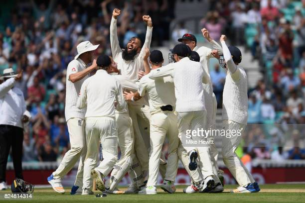 Moeen Ali of England celebrates with team mates after completing his hat trick to give England victory during the 3rd Investec Test between England...