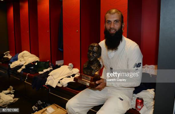 Moeen Ali of England celebrates with the series trophy in the dressing room after winning the Investec Test series between England and South Africa...