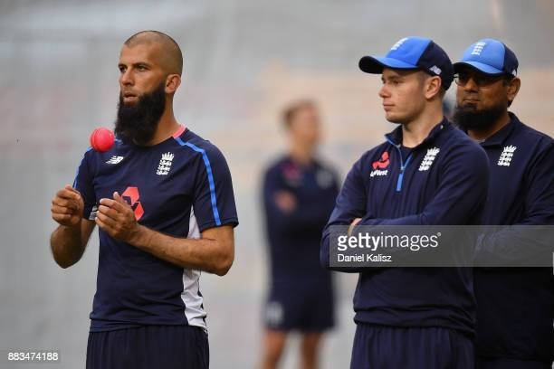 Moeen Ali of England chats with Saqlain Mushtaq spinbowling Coach of England and Mason Crane of England during an England nets session at Adelaide...