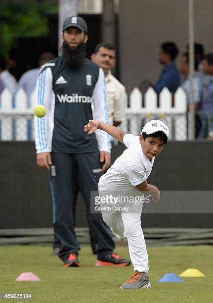 Moeen Ali of England coaches local children during a charity event at R. Premadasa Stadium on November 28, 2014 in Colombo, Sri Lanka.